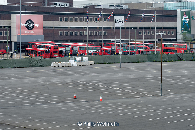 Coronavirus pandemic.  Empty car park and parked up buses at Brent Cross Shopping Centre, London.  All shops except food stores and a pharmacy in the retail park are closed during the Covid-19 lockdown.