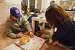 February 26, 2012, Tokyo, Japan - A couple plays with rabbits roaming the floor at a rabbit cafe where customers can come in to have a drink and play with rabbits. (Photo by Christopher Jue/AFLO)