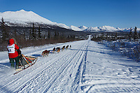 Rose Capistrant and team run down the trail on the Denali Highway with the Alaska Range in the background during the start day of the 2015 Junior Iditarod on Sunday March 1, 2015<br /> <br /> <br /> <br /> (C) Jeff Schultz/SchultzPhoto.com - ALL RIGHTS RESERVED<br />  DUPLICATION  PROHIBITED  WITHOUT  PERMISSION