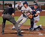 Reno Aces catcher Ryan Budde tags out Tucson Padres runner Daniel Robertson as he crashs into him at home during their game on Sunday night, September 2, 2012 at Aces Ballpark in Reno, NV.