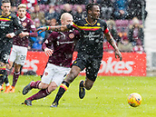 17th March 2018, Tynecastle Park, Edinburgh, Scotland; Scottish Premier League football, Heart of Midlothian versus Partick Thistle;  Christophe Berra of Hearts holds back Steven Naismith of Hearts