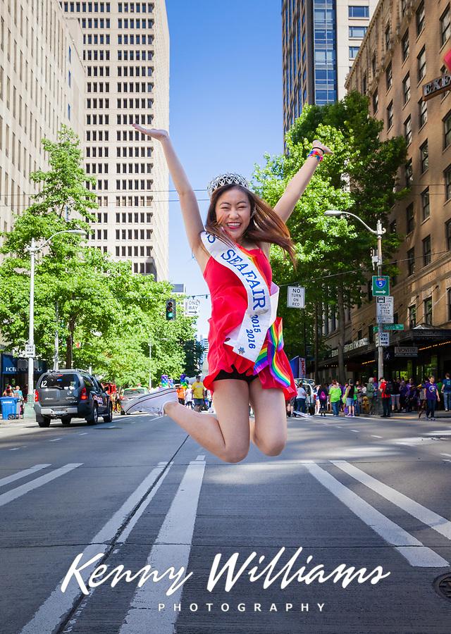 Miss Seafair Nella Kwan jumping for joy, Seattle Pride Parade 2016, Washington, USA.