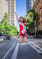 Miss Seafair Nella Kwan jumping for joy, Seattle Pride Parade 2016, Washington, USA.