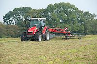 Raking grass ready to bale, Cheshire.