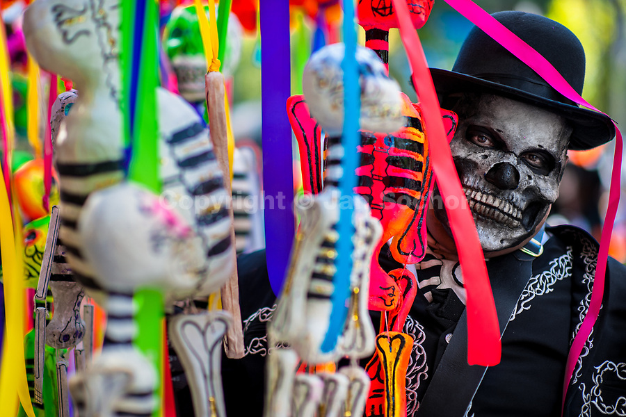 A Mexican man, dressed as skeleton (Calaca), takes part in the Day of the Dead festivities in Mexico City, Mexico, 29 October 2016. Day of the Dead (Día de Muertos), a syncretic religious holiday combining the death veneration rituals of the ancient Aztec culture with the Catholic practice, is celebrated throughout all Mexico. Based on the belief that the souls of the departed may come back to this world on that day, people gather at the gravesites in cemeteries praying, drinking and playing music, to joyfully remember friends or family members who have died and to support their souls on the spiritual journey.