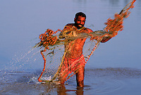 Fishermen outside Harappa use nets with terra cotta weights just like the ones found in ancient Harappa.  4,800 years ago, at the same time as the early civilizations of Mesopotamia and Egypt, great cities arose along the flood plains of the Indus and Saraswati (Ghaggar-Hakra) rivers.  Developments at Harappa have pushed the dates back 200 years for this civilization, proving once and for all, that this civilization was not just an offshoot of Mesopotamia..They were a highly organized and very successful civilization.  They built some of the world's first planned cities, created one of the world's first written languages and thrived in an area twice as large as Egypt or Mesopotamia for 900 years (1500 settlements spread over 280,000 square miles on the subcontinent)..There are three major communities--Harappa, Mohenjo Daro, and Dholavira. The town of Harappa flourished during this period because of it's location at the convergence of several trade routes that spanned a 1040 KM swath from the northern mountains to the coast.