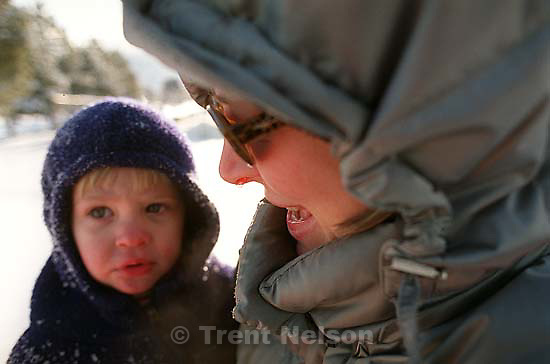Nathaniel Nelson and Laura Nelson with drippy nose sledding at Sugarhouse Park<br />