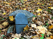 Pawtuckaway State Park - Old weathered broken headstone at Tower Hill Cemetery in Nottingham, New Hampshire. This cemetery dates back to the 19th century mountain settlement that was once in the area.