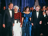 From left to right: United States President-elect George H.W. Bush, Barbara Bush, Marilyn Quayle, and US Vice President-elect Dan Quayle, attends the Inaugural Gala at the Washington DC Convention Center in Washington, DC on January 18 1989.   <br /> Credit: David Burnett / Pool via CNP