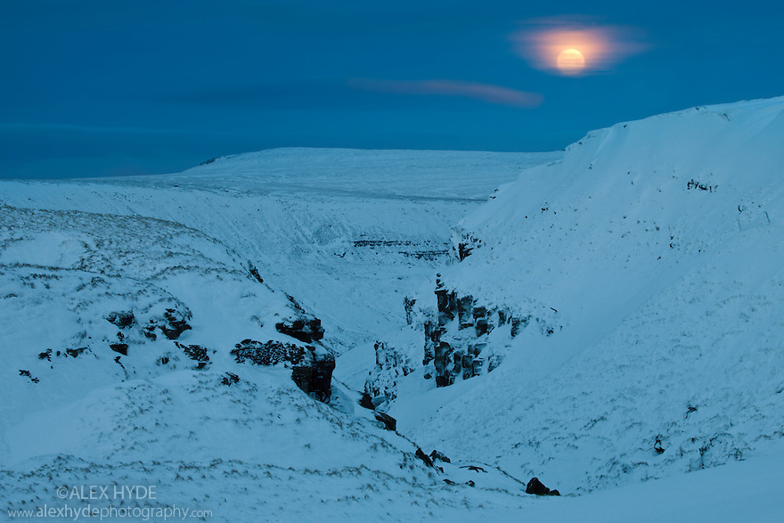 Full moon over Alport Castles, a landscape feature resulting from a huge landslip at the end of the last ice age. Peak District National Park, Derbyshire, UK. December.