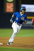 Mike Brosseau (9) of the Durham Bulls rounds third base after hitting a 3-run home run against the Louisville Bats at Durham Bulls Athletic Park on May 28, 2019 in Durham, North Carolina. The Bulls defeated the Bats 18-3. (Brian Westerholt/Four Seam Images)