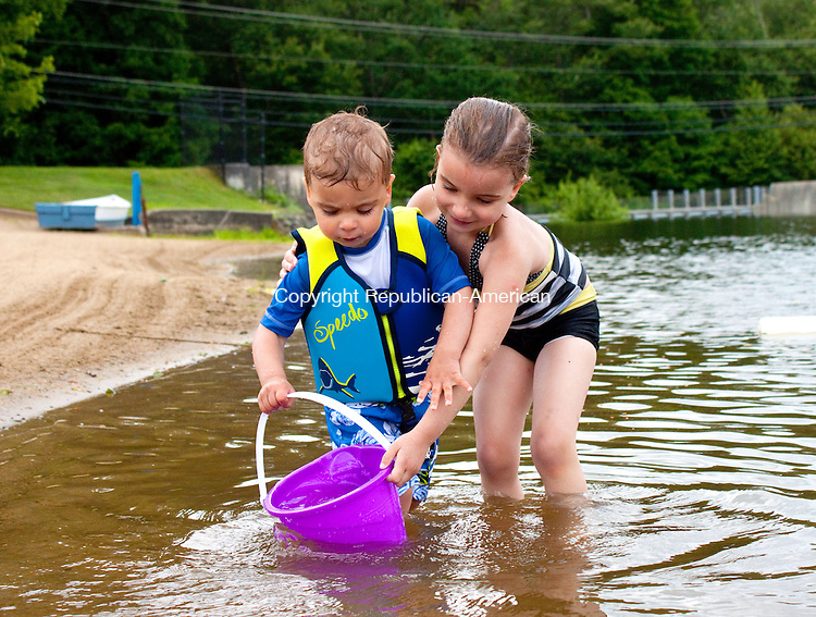 WOLCOTT - JUNE 18 2014 061814DA02- Gianna Lucarelli 4, right, of Wolcott gives her brother Dominic, 2, a hand filling up a pail with water on a hot and humid Wednesday afternoon at Woodtick Recreation Area in Wolcott.<br /> Darlene Douty Republican American