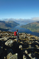 A walker ascending Sgorr na Ciche (The Pap of Glencoe), above Glencoe. Loch Linnhe and the Ardgour peninsula lie behind.<br /> <br /> Copyright www.scottishhorizons.co.uk/Keith Fergus 2011 All Rights Reserved