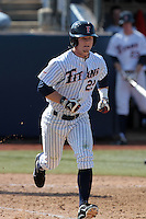 Austin Diemer #22 of the Cal State Fullerton Titans runs to first base against the TCU Horned Frogs at Goodwin Field on February 26, 2012 in Fullerton,California. Fullerton defeated TCU 11-10.(Larry Goren/Four Seam Images)