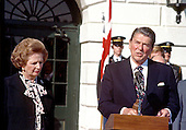 Washington, DC - (FILE) -- United States President Ronald Reagan, right, issues a joint statement as Prime Minister Margaret Thatcher of Great Britain, left, listens outside the Diplomatic Entrance of the White House following their 2 hour meeting in Washington, D.C. on Wednesday, February 20, 1985..Credit: Arnie Sachs / CNP