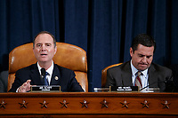 United States Representative Adam Schiff (Democrat of California), Chairman, US House Permanent Select Committee on Intelligence (L), with United States Representative Devin Nunes (Republican of California), Ranking Member, US House Permanent Select Committee on Intelligence (R), delivers his  closing remarks during the House Permanent Select Committee on Intelligence public hearing on the impeachment inquiry into US President Donald J. Trump, on Capitol Hill in Washington, DC, USA, 19 November 2019. The impeachment inquiry is being led by three congressional committees and was launched following a whistleblower's complaint that alleges US President Donald J. Trump requested help from the President of Ukraine to investigate a political rival, Joe Biden and his son Hunter Biden.<br /> Credit: Shawn Thew / Pool via CNP/AdMedia