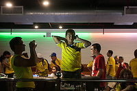 New York, NY - Saturday, June 14, 2014: A young Colombia fans has his photograph taken while cheering on their team during the Colombia vs. Greece first round World Cup match at a billiards halls in the Jackson Heights neighborhood of Queens, New York.