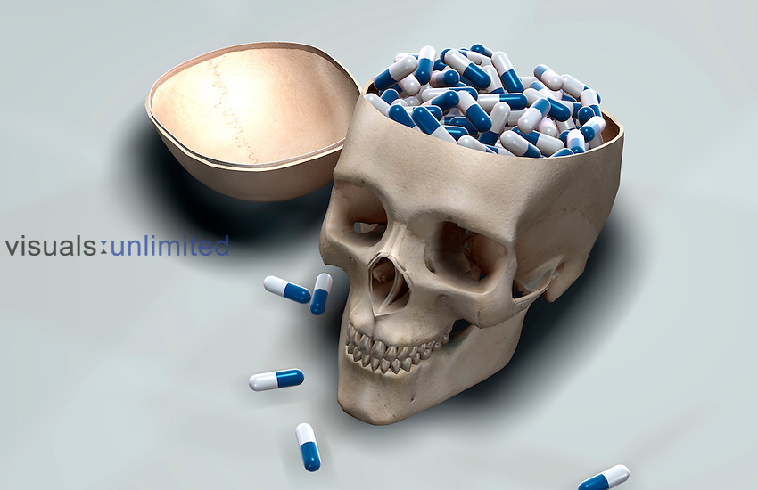 A skull filled with pills. Royalty Free