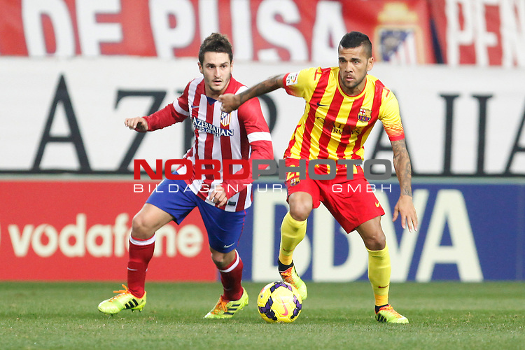 Atletico de Madrid¬¥s Koke and Barcelona¬¥s Dani Alves (R) during La Liga match at Vicente Calderon stadium in Madrid, Spain. January 11, 2014. Foto © nph / Victor Blanco)