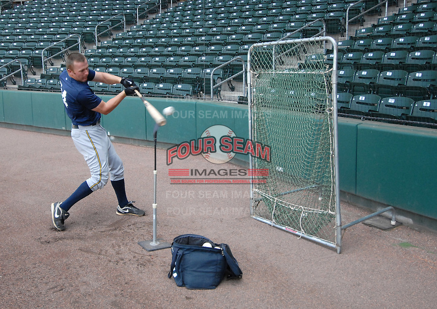 Infielder Luke Murton (34) of the Charleston RiverDogs hits balls off a tee during batting practice prior to a game against the Greenville Drive on May 27, 2010, at Fluor Field at the West End in Greenville, S.C. Photo by: Tom Priddy/Four Seam Images