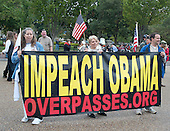 """Members of the """"Million Veterans March on the Memorials"""" carry a sign during the protest about the closing of the memorials on the National Mall due to the partial shut-down of the government on Pennsylvania Avenue near the White House in Washington, D.C. on Sunday, October 13, 2013.<br /> Credit: Ron Sachs / CNP"""