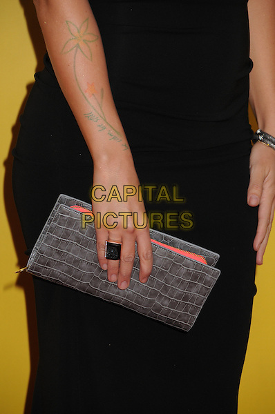 Colbie Caillat's hand .The 46th Annual CMA Awards, Country Music's Biggest Night, held at Bridgestone Arena, Nashville, Tennessee, USA, .1st November 2012..arrivals cmas music detail arm tattoo ring clutch bag flower  grey gray croc animal skin .CAP/ADM/BP.©Byron Purvis/AdMedia/Capital Pictures.