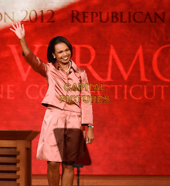 Former United States Secretary of State Condoleezza Rice makes remarks at the 2012 Republican National Convention in Tampa Bay, Florida on Wednesday, August 29, 2012.  .half 3/4 length pink skirt silk satin shirt hand arm in air waving .CAP/ADM/CNP/RS.©Ron Sachs/CNP/AdMedia/Capital Pictures