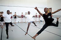 CAPE TOWN, SOUTH AFRICA - MARCH 6: Sikhumbuzo Hlahleni (center), age 15, trains jumps with other students at Cape Town City Ballet's youth company on March 6, 2010 in Cape Town, South Africa. He trains in Cape Town every Saturday. He also trains a few days week at home in Khayelitsha, a poor township outside Cape Town. (Photo by Per-Anders Pettersso).