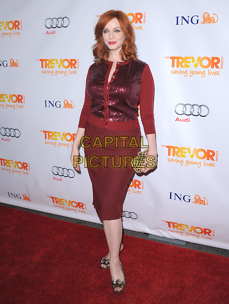Christina Hendricks.Trevor Live at The Hollywood Palladium in Hollywood, California, USA..December 4th, 2011  .full length maroon burgundy skirt clutch bag red sequins sequined cardigan.CAP/RKE/DVS.©DVS/RockinExposures/Capital Pictures.