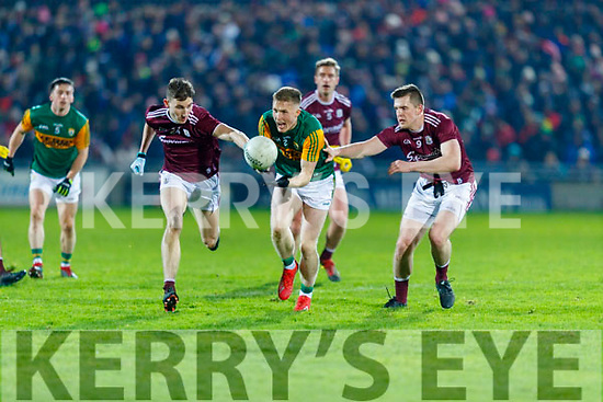 Jason Foley, Kerry in action against Matthew Tierney and Cein D'Arcy, Galway during the Allianz Football League Division 1 Round 2 match between Kerry and Galway at Austin Stack Park in Tralee, Kerry.