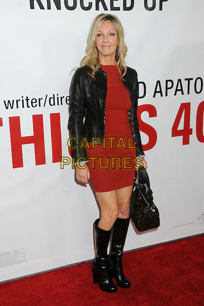 "Heather Locklear.""This Is 40"" Los Angeles Premiere held at Grauman's Chinese Theatre, Hollywood, California, USA..December 12th, 2012.full length black leather jacket red dress boots bag purse .CAP/ADM/BP.©Byron Purvis/AdMedia/Capital Pictures."