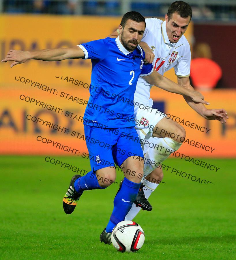 Fudbal<br /> Prijateljski mec-Friendly match<br /> Srbija v Grcka<br /> Ioannis Maniatis (L) and Radosav Petrovic<br /> Chania, 17.11.2014.<br /> foto: Srdjan Stevanovic/Starsportphoto &copy;