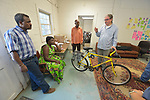 Greg Garneau, a volunteer who coordinates the refugee bike program for the Durham Bicycle Co-op, explains bicycle basics to newly arrived refugees in Durham, North Carolina.<br /> <br /> The Co-op works closely with Church World Service, an agency that resettles refugees in North Carolina and throughout the United States.<br /> <br /> Photo by Paul Jeffrey for Church World Service.