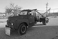 """The Tow Truck that inspired the Cars Film Character Mater. At the corner """"Four Women on the Route"""" Front and S. Main Streets, Galena, KS on old Route 66. Side View with Beer Keg. B&W Conversion"""