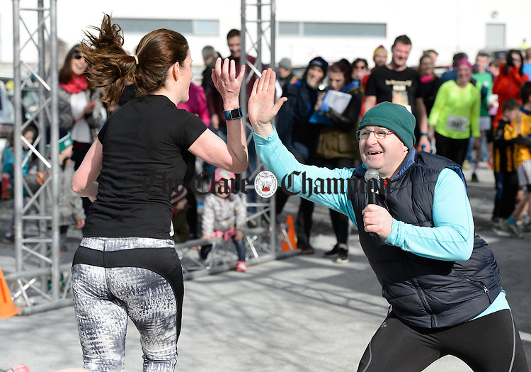 MC Marty Guinnane high fives the runners as they head for the finish at the Hurley-Hoey Memorial 10km run, walk and cycle which started at St Joseph's Doora Barefield complex at Gurteen. Photograph by John Kelly.