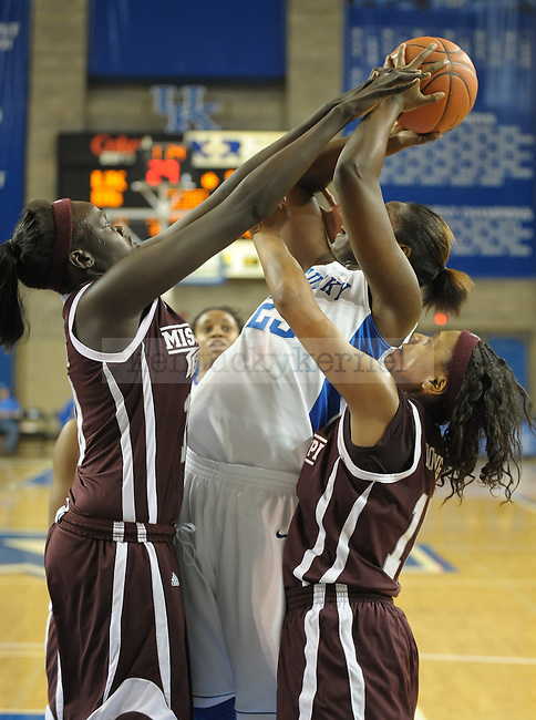 Kentucky's Samarie Walker (23) is fouled under the basket during the second half of the University of Kentucky Women's basketball game against Mississippi State at Memorial Coliseum in Lexington, Ky., on 1/8/12. Uk won the game 88-40. Photo by Mike Weaver | Staff