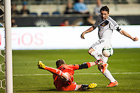 Philadelphia Union goalkeeper Zac MacMath (18) punches the ball away from Robbie Keane (7) of the Los Angeles Galaxy during a Major League Soccer (MLS) match at PPL Park in Chester, PA, on May 15, 2013.