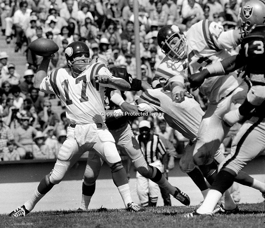 St.Louis Cardinals QB Jim Hart under pressure from Oakland Raiders pass rush. (1973 photo/Ron Riesterer)