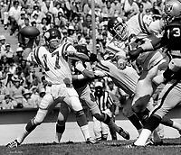 St.Louis Cardinals QB Jim Hart under pressure from Oakland Raiders pass rush. (1973 photo/Ron Riesterer)