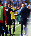 Miguel Angel Britos of Watford is spoken to by the fourth official Bobby Madley after his Red Card during the premier league match at the Vicarage Road Stadium, Watford. Picture date 26th August 2017. Picture credit should read: Robin Parker/Sportimage