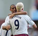 West Ham's Anton Ferdinand celebrates with goalscorer Dean Ashton. .Pic SPORTIMAGE/David Klein