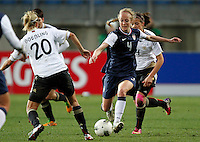 US's Rebecca Sauerbrunn fights for the ball with Germany's Lena Goebling during their Algarve Women's Cup soccer match at Algarve stadium in Faro, March 13, 2013.  .Paulo Cordeiro/ISI