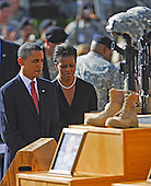 Fort Hood, TX - November 10, 2009 -- U.S. President Barack Obama and his wife First Lady Michelle Obama review the dead at the memorial service for the 12 soldiers and one civilian killed at Fort Hood U.S Army Post near Killeen, Texas, USA 10 November 2009. Army Major Malik Nadal Hasan reportedly shot and killed 13 people, 12 soldiers and one civilian, and wounded 30 others in a rampage 05 November at the base's Soldier Readiness Center where deploying and returning soldiers undergo medical screenings.  .Credit: Tannen Maury / Pool via CNP