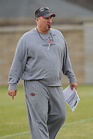 NWA Media/ANDY SHUPE - Arkansas coach Bret Bielema watches his players during practice Saturday, Dec. 13, 2014, at the university's practice facility in Fayetteville.