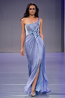 Model walks the runway in an Haute Couture outfit by Lebanese designer Mireille Dagher, for her Mireille Dagher Salon de Couture Spring Summer 2012 collection, during Couture Fashion Week, Spring 2012.