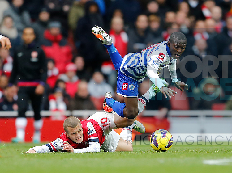 Arsenal's Jack WIlshere tussles with QPR's Shaun Wright-Phillips..Arsenal v QPR - Barclays Premier League - The Emirates Stadium, London- 27/10/12 - Picture David Klein/Sportimage