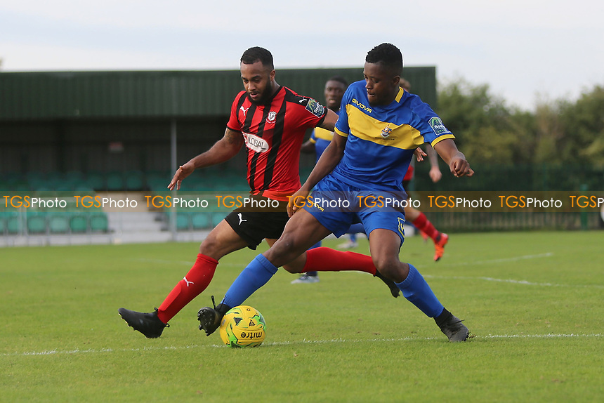 Khadean Campbell of Romford and Syrus Gordan of Coggeshall during Romford vs Coggeshall Town, Bostik League Division 1 North Football at Rookery Hill on 13th October 2018