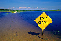 Flooded farm fields and road sign<br /> St. Agathe<br /> Manitoba<br /> Canada