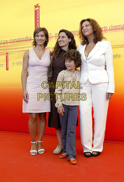 TERESA SAPONANGELO, VALIA SNATELLA, CAMILLA DI NICOLA & STEFANIA SANDRELLI.61st Venice Film Festival.September 3rd, 2004.full length, striped dress, white suit.www.capitalpictures.com.sales@capitalpictures.com.© Capital Pictures.