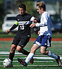 Joey Dinetz #13 of Wheatley, left, gets pressured by Harry Ludwig #17 South Side during a non-league varsity boys soccer game at South Side High School on Monday, Oct. 10, 2016. South Side won by a score of 6-0.
